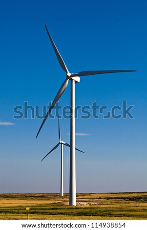 wind mills on blue sky in vertical composition