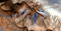 wind pottery, abstract photography of the deserts of Africa from the air, aerial view of desert landscapes, Genre: Abstract Naturalism, from the abstract to the figurative, contemporary photo art