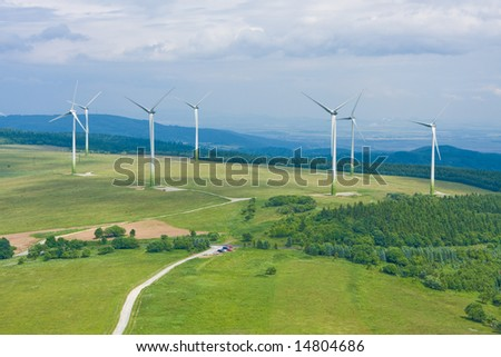 Wind power farm installation in sunny day