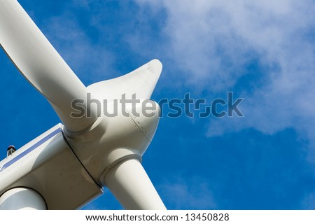 Wind power installation  with blue sky - stock photo