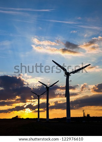 Wind power landscape at sunset.