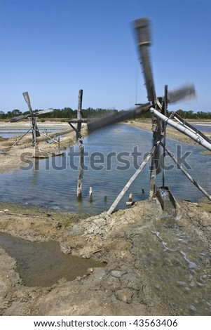 Wind Power - Sea water transfer powered by wind on sea salt pans in Indonesia