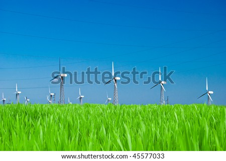 Wind power station - wind turbine against the blue sky