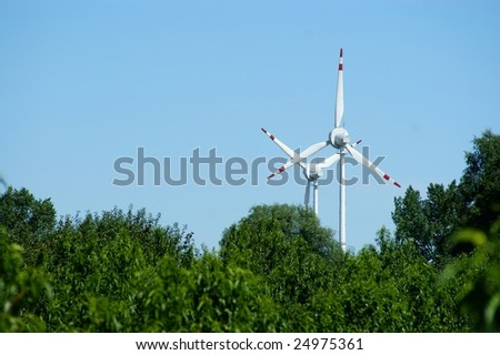 Wind power turbine, forest - blue sky