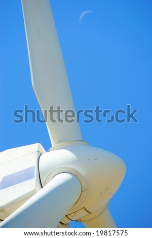 Wind power - turbine installation with blue sky and moon