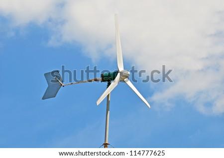 Wind power turbine on blue sky background