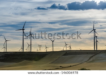 Wind power turbines at sunset