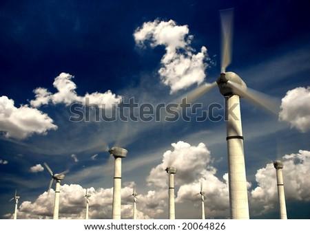 Wind power turbines with sky background