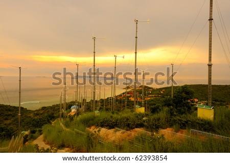 Wind power under sunset near sea shore , wind power