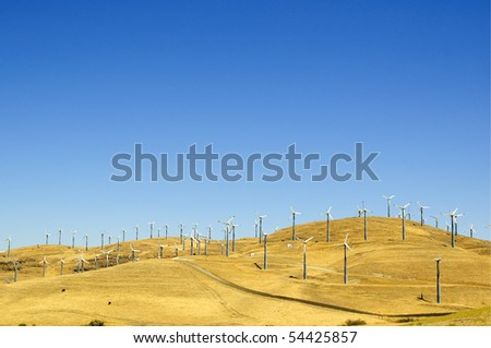 Wind powered electrical generators on a hillside in northern California - stock photo