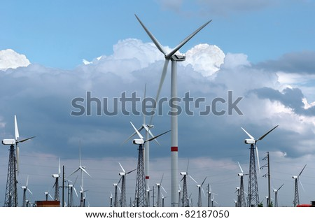 Wind-powered generators against clouds and blue sky