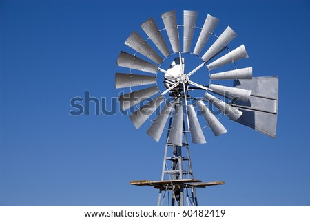 Wind pump against a blue sky