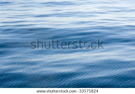 wind ripples on the surface of a calm ocean