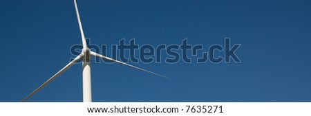 Wind turbine against a blue sky background
