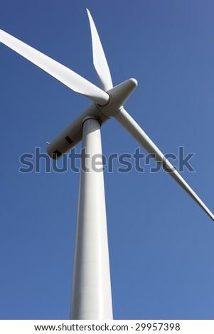 Wind turbine against clear blue sky