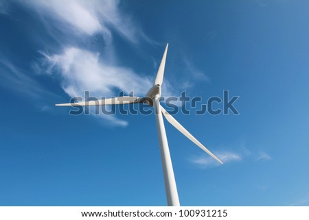 Wind turbine against cloud