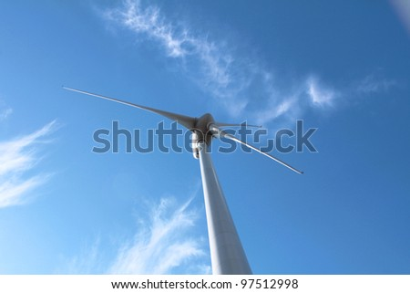 Wind turbine against clouds