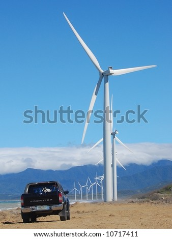wind turbine and a pickup - stock photo