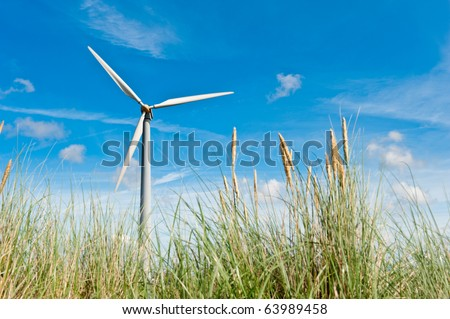 wind turbine and sand dunes in the netherlands