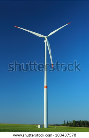 Wind turbine as alternative energy source against clear blue sky