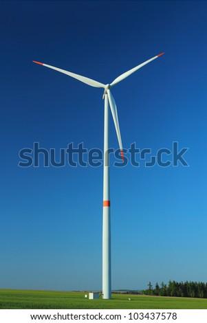 Wind turbine as alternative energy source against clear blue sky