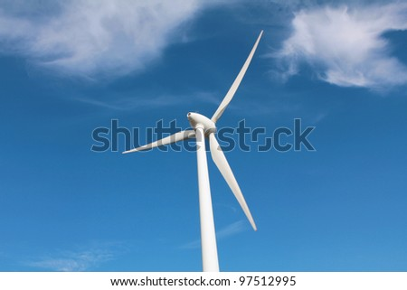 Wind turbine between clouds