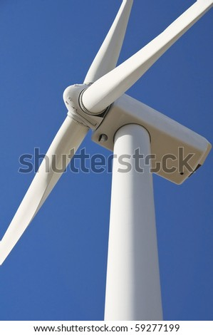 Wind turbine blade at blue sky. - stock photo
