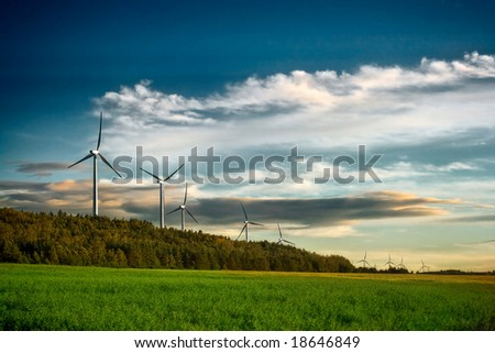 Wind turbine farm at sunset in Canada