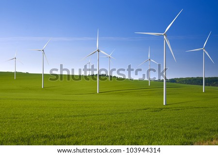 Wind turbine farm in the field - a renewable energy source