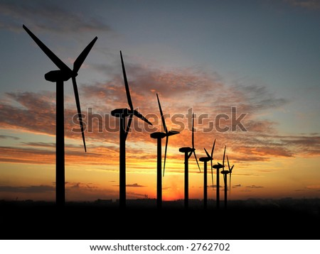 Wind turbine farm over sunset