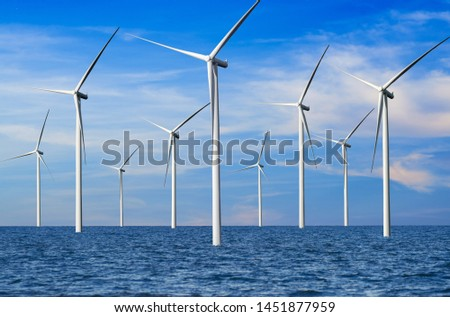 Wind turbine farm power generator in beautiful nature landscape for production of renewable green energy is friendly industry to environment. Concept of sustainable development technology. Stock photo ©