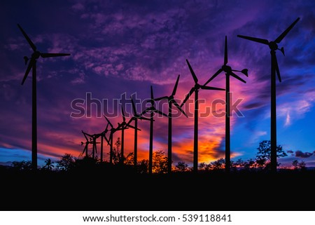 Wind Turbine for alternative energy silhouette at sunset. Eco power.