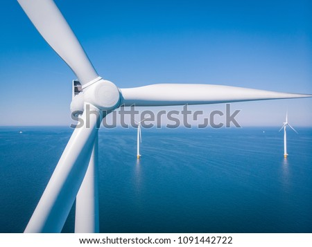 Photo of  Wind turbine from aerial view, Drone view at windpark westermeerdijk a windmill farm in the lake IJsselmeer the biggest in the Netherlands,Sustainable development, renewable energy