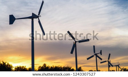 wind turbine generator for green energy with space for text in the evening sky sunset   #1243307527