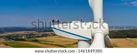 wind turbine in a field aerial picture close up