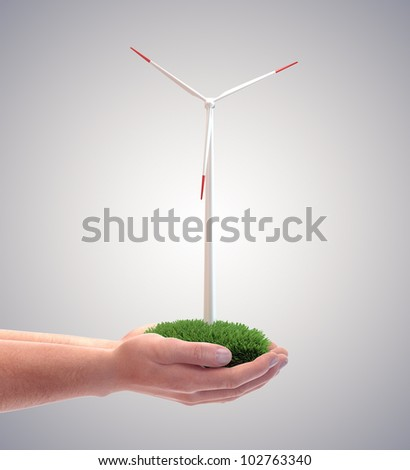 Wind turbine in a man's hand