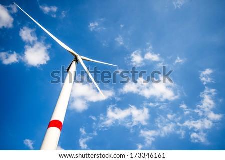 Wind turbine in daylight against bright blue sky Stock photo ©