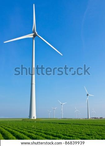 Wind turbine in dutch agricultural landscape