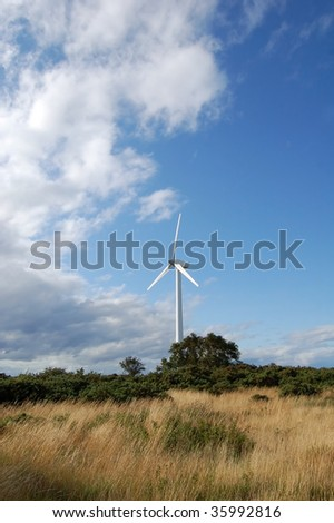 Wind turbine in rural location in the north of Scotland near Findhorn, producing electricity for sustainable communities of the future