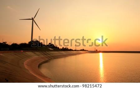 wind turbine in sunset