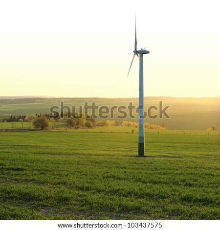 Wind turbine in the field - square composition - stock photo