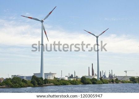 Wind turbine in the industrial area of Hamburg harbor.