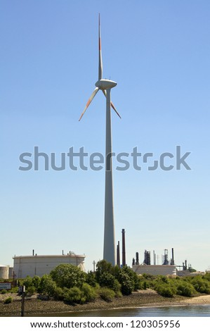 Wind turbine in the industrial area of Hamburg harbor.