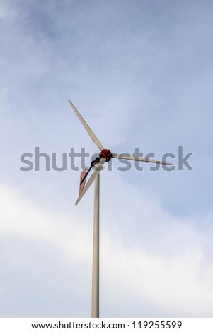 Wind turbine located in school against twilight blue sky background, Phuket, Thailand