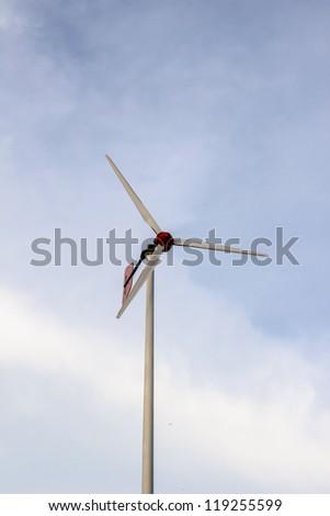 Wind turbine located in school against twilight blue sky background, Phuket, Thailand