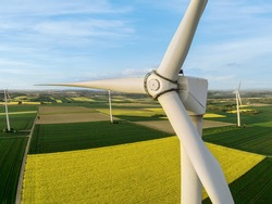 Wind turbine on a field, aerial photo