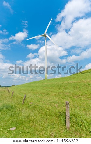 wind turbine on a green hill