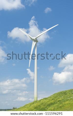 wind turbine on a green hill