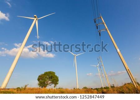 Wind Turbine on a Wind Farm with electric pole #1252847449