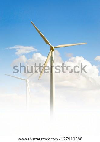 Wind turbine on bright blue sky, producing clean energy